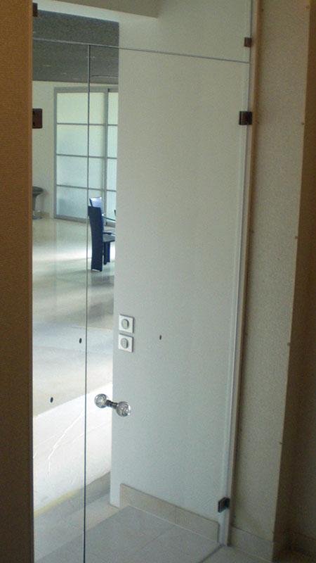Installation d'une porte en verre Val-d'Oise