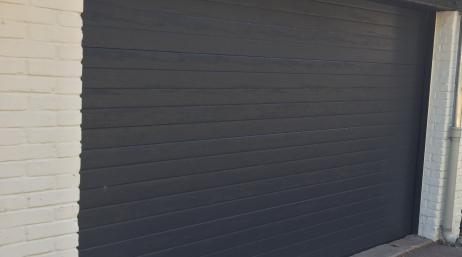 Remplacement porte de garage enroulable 95