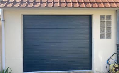 Remplacement porte de garage sectionnelle 95 image 2