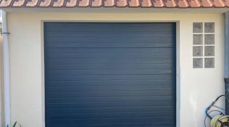 Remplacement porte de garage sectionnelle 95