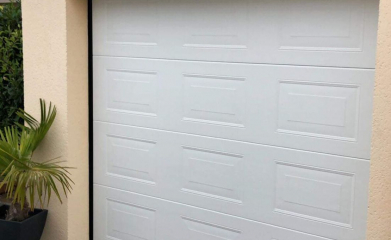 Pose et remplacement d'une porte de garage sectionnelle image 2